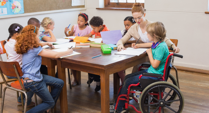 Class with child in wheelchair