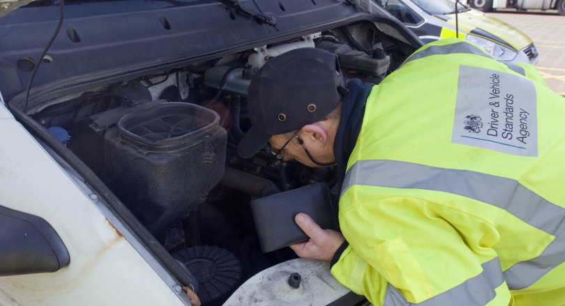 DVSA officer inspects vehicle